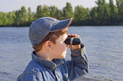 A boy with binoculars Royalty Free Stock Photos