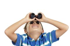 Boy and binoculars Stock Images