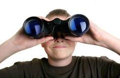 Boy with binoculars Royalty Free Stock Image