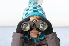 Boy with binoculars Royalty Free Stock Photography