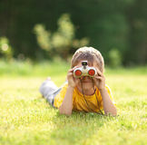 Boy with binoculars Royalty Free Stock Images