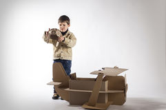 Boy and biplane. Stock Images