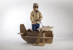 Boy and biplane. Stock Photography