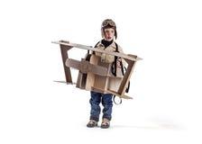 Boy and biplane. Royalty Free Stock Photo