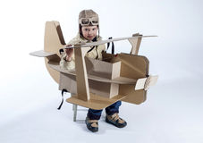 Boy and biplane. Royalty Free Stock Images