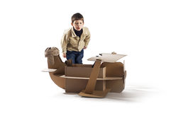 Boy and biplane. Stock Image