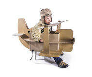 Boy and biplane. Stock Photo