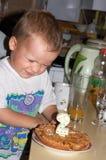 Boy with birthday cake Stock Photography
