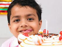 Boy with birthday cake Stock Photos