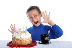 Boy with birthday cake. Little boy with birthday cake isolated on white Royalty Free Stock Image