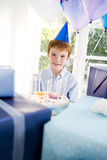 boy with birthday cake at party Stock Photography