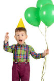 Boy with birthday cap and balloons Stock Photography