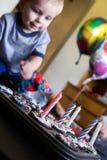 Boy and birthday cupcakes Stock Photos