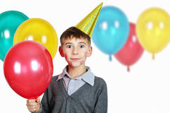 Boy in birthday hat Stock Photography