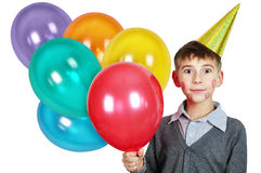 Boy in birthday hat. With colorful balloons over white Stock Photography