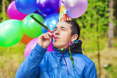 Boy in a birthday party at outdoors Royalty Free Stock Photo