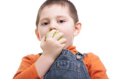 Boy biting apple Stock Photography