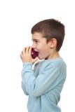 Boy biting apple stock photo