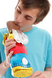 Boy biting ear of chocolate rabbit Royalty Free Stock Photo