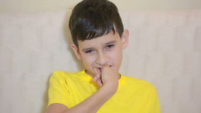 Boy biting his nails obsessive-compulsive disorder, child psychology stock footage