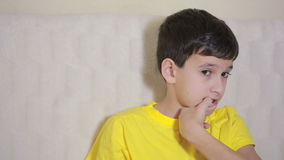 Boy biting his nails obsessive-compulsive disorder, child psychology stock video footage