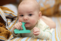 Boy biting letter Stock Image