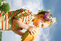 Boy biting a loaf of bread Stock Images