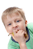 Boy biting a paer Stock Images