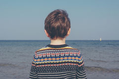 Boy in Black Blue White Sweater Near Shore during Daytime Stock Photography