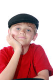 Boy in black cap. Cute young tween boy wearing paperboy cap and red shirt, isolated on white Royalty Free Stock Photo