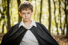 Boy with black cape Stock Photo