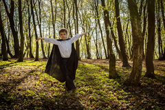Boy with black cape Royalty Free Stock Image