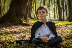 Boy with black cape Stock Images