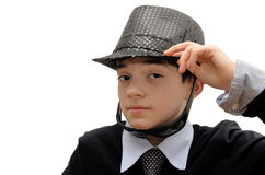 Boy with black carnival costume. Teenager in a carnival costume, wearing hat and sunglasses and making a pose. Image isolated on white Stock Photo
