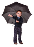 Boy in black clothes standing under umbrella Royalty Free Stock Image