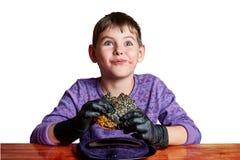 Boy in black gloves emotionally eating a burger stock photos