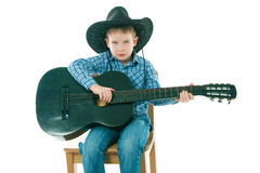 The boy with a black guitar Royalty Free Stock Image