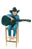 The boy with a black guitar Stock Photos