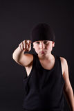 Boy in black hat points the finger Stock Photography