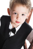 The boy in a black suit Stock Photos