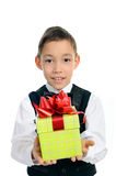 Boy in black suit holding green gift box isolated Stock Photos