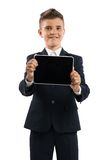 Boy in black suit showing tablet computer Stock Images