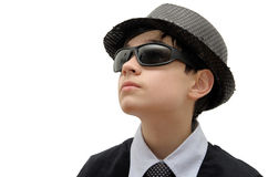 Boy with black sunglasses. Man in black. Teenager in a carnival costume, wearing hat and sunglasses as a detective. Image isolated on white Stock Photo