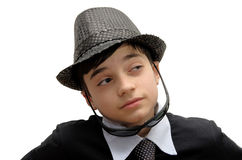 Boy with black sunglasses. Young Teenager in a black carnival costume, wearing hat and sunglasses as a detective. Image isolated on white Royalty Free Stock Photos