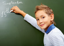 Boy at blackboard Stock Photography