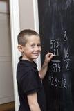 Boy at the blackboard Royalty Free Stock Photos