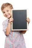 Boy with blackboard. Portrait of a little boy holding a blackboard over white background Royalty Free Stock Images