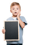 Boy with blackboard. Portrait of a little boy holding a blackboard over white background royalty free stock image
