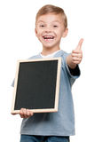 Boy with blackboard Stock Image