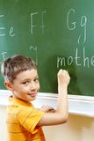 Boy at blackboard Royalty Free Stock Photography